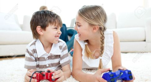 10244299-close-up-of-children-playing-video-games-stock-photo-family